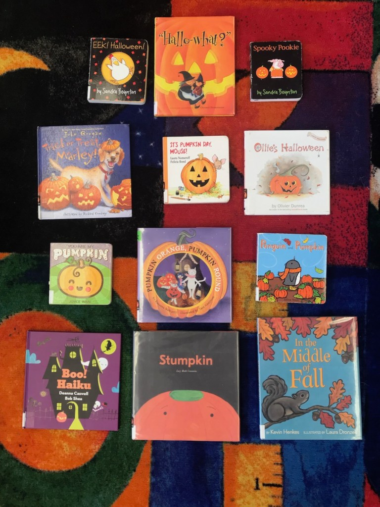 selection of fall and halloween themed books for toddlers and children at the library