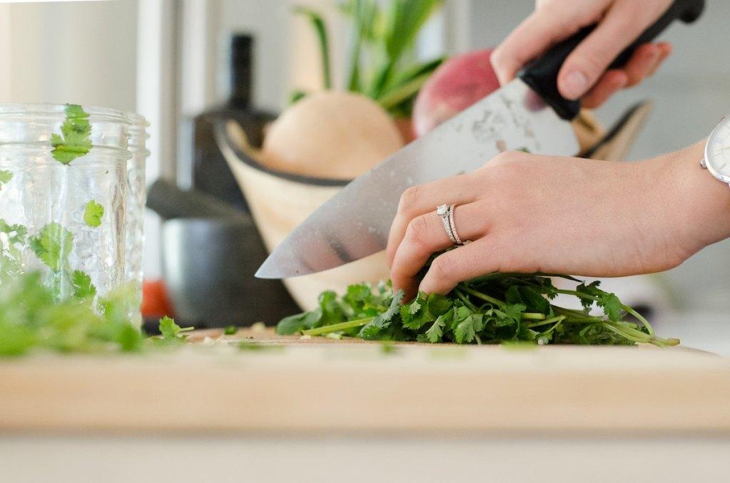 woman preparing meal for dinner for her family