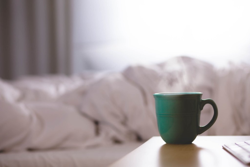 green coffee mug for mom starting her morning routine