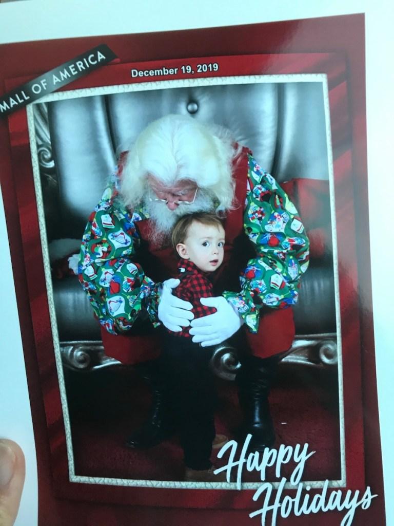 toddler hugging santa claus