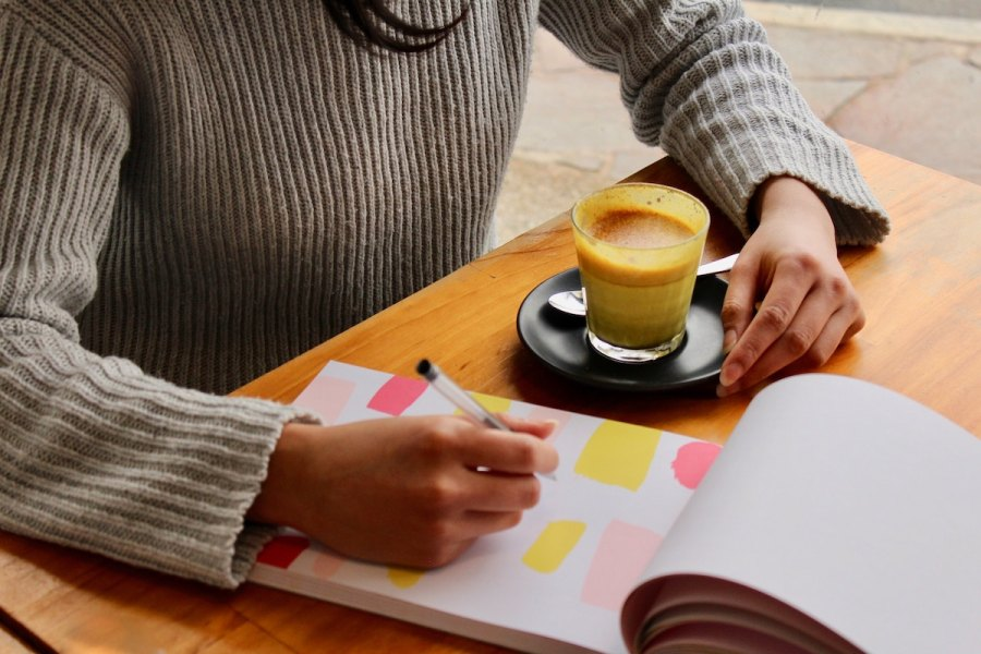 woman planning out meals on notepad